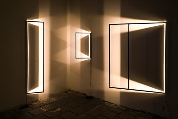 The Maya elements take the form of an empty frame and form a collection of light sculptures that emit a seductive light and add a new dimension to an otherwise flat wall. © Luiza Guidi