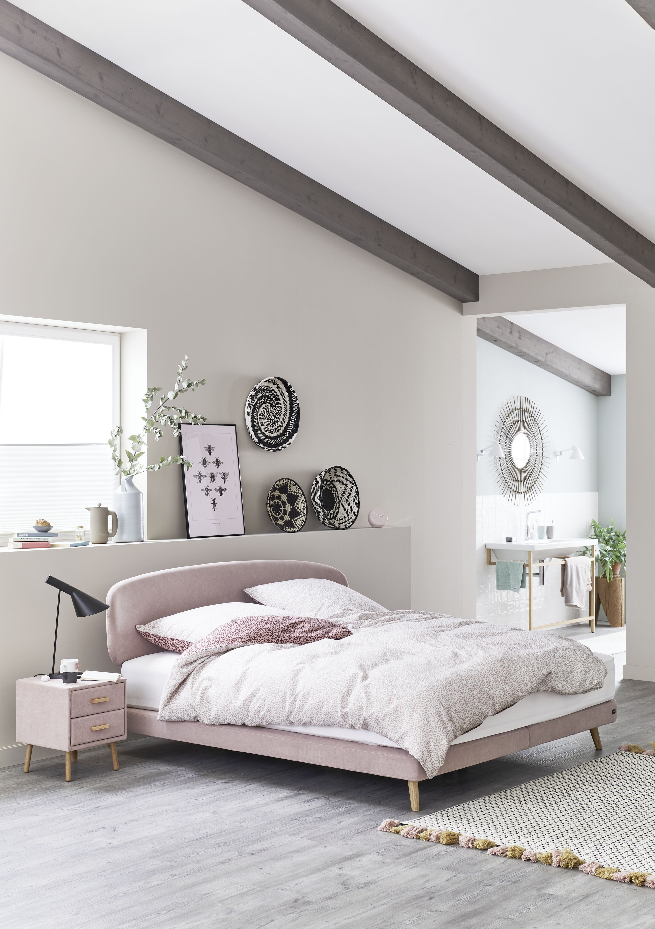 The bedroom, with current furniture from the assortment of the
