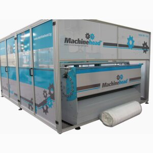 COMPRESSING AND ROLL-PACKING MACHINE