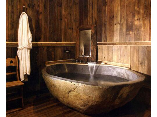 freestanding natural stone bathtub made of river stone | pattern by ...
