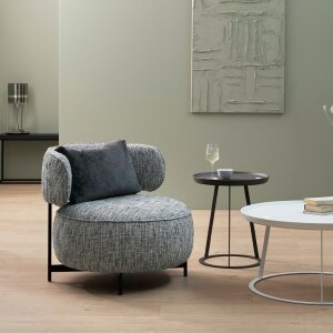 Armchair and pouf from the Characters series